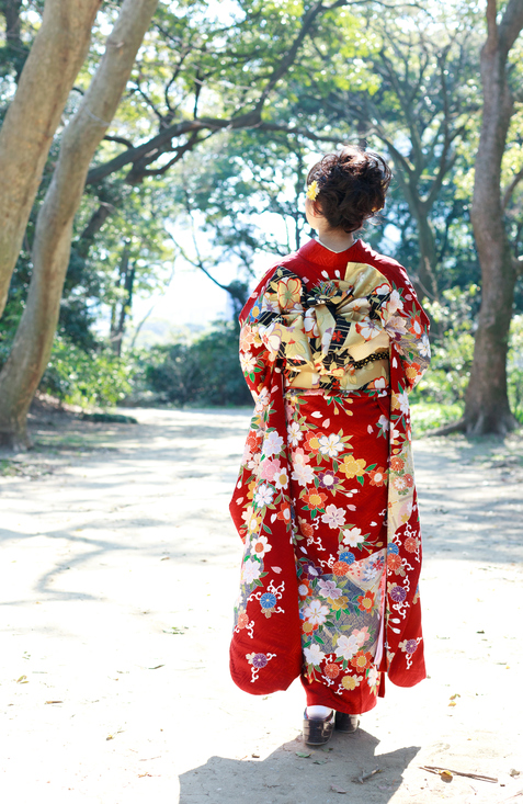 Young woman wearing Japanese kimono in the forest.